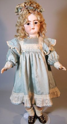 This 1079 mold Simon Halbig doll is definitely one of the earlier dolls made from this mold, she is exquisite with her huge almond cut brown eyes!