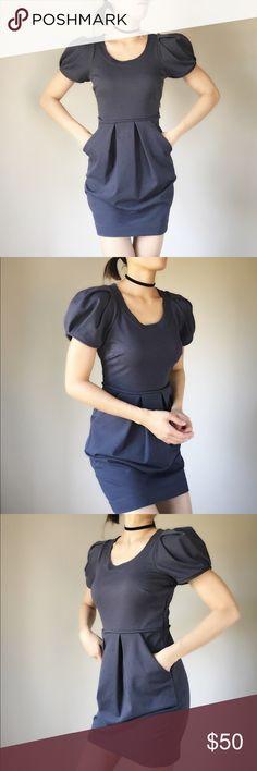 "BCBG chic cocktail dress with hidden side pocket. BCBG mini flower dress . Side zip up. Fold petal shoulder detailing. Side pocket . Great thick material.. well made.Pleated front. Shell 70%polyblend 25%rayon 5%spandex. Contrast 100%cotton. Shoulder 11"" bust 15"". Length 32.5"" waist 13.5""hip 17.5"". BCBGeneration Dresses Mini"