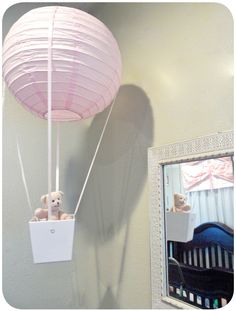 Very cute DIY idea for a baby's room.  Could be made blue for a boy too.