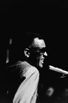 """""""Musician Ray Charles performing at a microphone, c. 1960."""""""