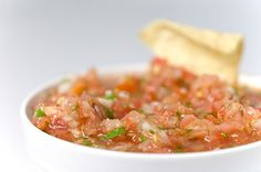 Fresh and spicy salsa - I think I'll add a little less heat for mine, and a little more for my spice babies :)