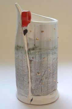 Cylinder vessel with raised gold dots 2005 © Linda Styles Ceramics