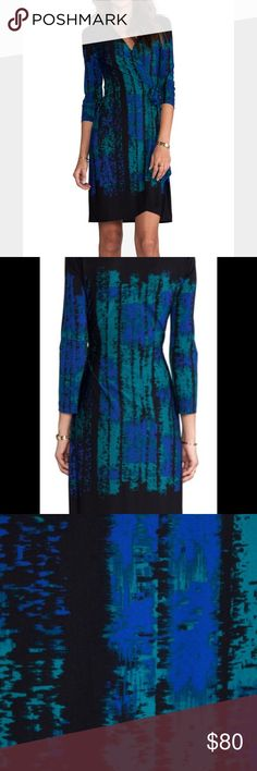 BCBG Adèle wrap dress BCBG Adèle wrap dress in teal combo color - as worn on Veep this season! Beautiful stretch jersey fabric and like new condition. Can be worn with tights and boots in colder weather and nice sleek heels in warmer weather. Perfect dress for day to night transition! BCBG Dresses