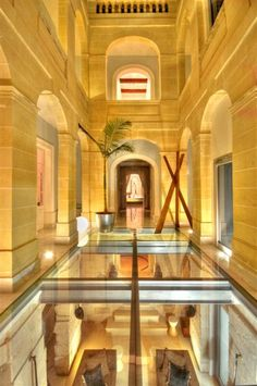 This Palazzo located on the Isle of Malta, just south of Sicily, features transparent glass flooring in a roofed courtyard that serves as an art gallery (you can see the art along the sides). Palazzo, Luxury Modern Homes, Beautiful Interior Design, Beautiful Interiors, Old Mansions, Glass Floor, Need A Vacation, Entry Hall, Sicily