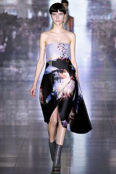 FALL 2013 READY-TO-WEAR  Mary Katrantzou /   Cristobal Balenciaga would create one single black dress each season to highlight his latest innovations in cut. He felt monochrome honed the eye to understand and appreciate his technique. A similar thought process motivated Mary Katrantzou with her new collection. Wanting, she said, to take her work forward, she shifted away from the prints and color palette that have fueled her meteoric rise, to a strong focus on shape and silhouette.