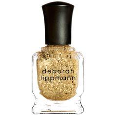 Deborah Lippmann's Boom Boom Pow....$20 nail polish that contains 24 ct gold dust. That is absurd. I wouldn't turn it down.