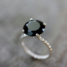 https://www.bkgjewelry.com/sapphire-ring/460-18k-yellow-gold-diamond-blue-sapphire-ring.html List of pretty affordable black diamond engagement rings
