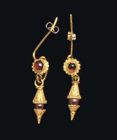 A PAIR OF GREEK GOLD AND GARNET EARRINGS   HELLENISTIC PERIOD, CIRCA 2ND-1ST CENTURY B.C.   Each with a plain hoop joined to a rosette centered by a bezel-set cabochon garnet, the sheet petals embellished with filigree, sheet cones suspended below ornamented with filigree tongues, capping a spherical garnet bead, an inverted granulated pyramid on the underside; joined to modern gold earwires