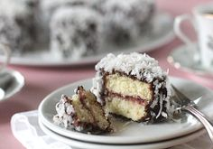 lamingtons: a 'down under' dessert by the galley gourmet. cake with cream or jam filling, frozen, then dipped in chocolate and rolled in coconut. Australian Desserts, Australian Food, Individual Desserts, Just Cakes, Coffee Cake, Let Them Eat Cake, Cupcake Cakes, Cupcakes, Just Desserts