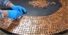 He Puts Hundreds Of Pennies On A Black Table. The End Result