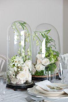 white flowers under glass bell centrepiece