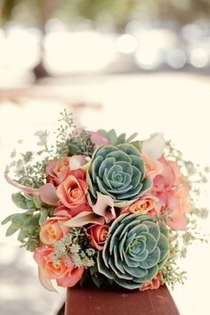 Pinks, coral, white, greens and blues: Rose and Succulent Bouquet (Image via REVEL/Onewed.com)