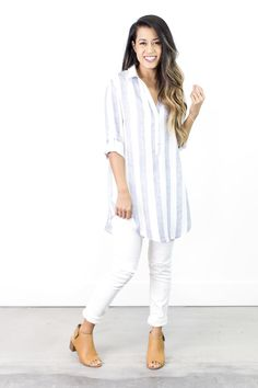 This breezy striped, split neck tunic will transition your wardrobe perfectly into spring and summer! DETAILS: Oversized lightweight collared split-neck striped hi-lo tunic. Fabric Content: 100% Rayon Care Instructions: Hand wash cold, dry clean. COLORS: Black Blue Gray SIZING + MEASUREMENTS: Small (0-6): Bust: 40\