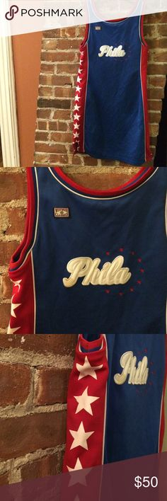 """VINTAGE Philadelphia Jersey Dress✨ Vintage Philadelphia basketball style jersey bodycon-esq dress. Super fun one of my favorite vintage picks. Blue back and front with """"Phila"""" logo as well as """"Westwood Classics"""" on the top left. Red with white star detail along the sides. This is such a great find!. Though the tags are no longer intact it fits like a true medium. Get it before it's gone forever!✨ Vintage Dresses"""