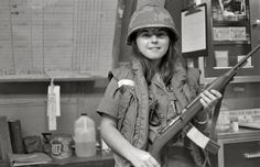 US Army nurse, posing with an M1 carbine during an hospital alert, Vietnam 1969