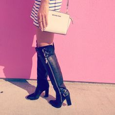 Kanako Ishida wearing Michael Kors Mini Selma bag and Fall 2013 Collection boots. Los Angeles, February 2014