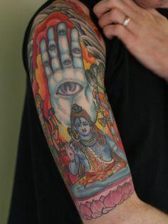 Colored aqua religious god shiva tattoo on half sleeve Half Sleeve Tattoos Designs, Best Sleeve Tattoos, Sleeve Tattoos For Women, Tattoo Sleeve Designs, Bull Tattoos, Eagle Tattoos, Tattoos Skull, Indian Tattoos, Tatoos