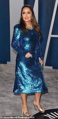 Hot metal: Salma Hayek dazzled in a blue sequinned dress, set off with a pair of metallic ...