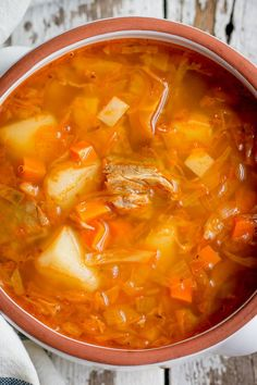 There are so many reasons to love Shchi - traditional Russian Cabbage Soup. It's hearty and filling thanks to the tender chunks of beef and the combo of sauerkraut and fresh cabbage. Russian Cabbage Soup Recipe, Cabbage Soup Recipes, Cabbage Soup Diet, Russian Dishes, Russian Recipes, Russian Foods, Ukrainian Recipes, Pork And Beef Recipe, Beef Recipes