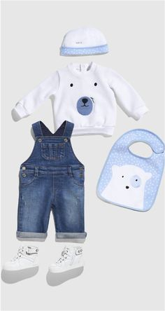 The Gucci Baby collection featuring denim overalls, a bear patch sweatshirt, white leather high-top sneakers, and a snow print hat.