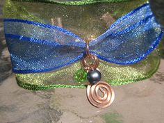 Peacock ribbon bracelet with freshwater pearl & copper spiral bySunshineDaydreamz on Etsy