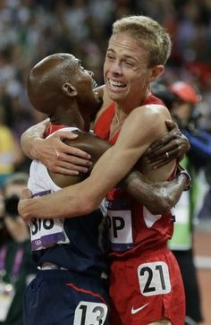 Britain's Mo Farah, left, and United States' Galen Rupp react after the men's 10,000-meter run. Farah won gold, and Rupp won silver.