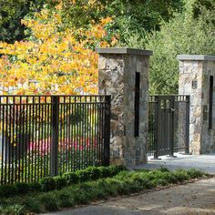 The Walk-by-me and take a look into my garden driveway gate .........Stone and wrought iron..