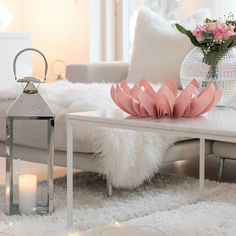 White living room with a pink Petals fruit bowl / Photo by @lovingwhitestyle