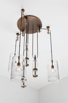 This Counterweight Chandelier from Alison Berger Glassworks was inspired by Galileo's gravitational pulley studies of the 1600s. Read more in Cambria Style.