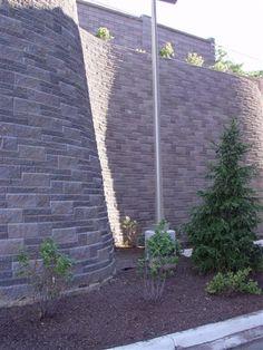 Allan Block retaining wall in an ashlar pattern - these small blocks can do a very big job!
