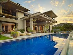 Luxurious Mexico Residence with Multiple Outdoor Living Spaces. Large negative edge pool and spa with blue tiled interior. Pinned to Pool Design by Darin Bradbury.