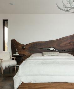 Wood slab headboard | Design by Pearson Design Group.