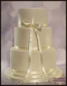 3 tiered Wedding cake with ribbon