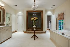 Master Bath: Champaign Limestone, Plaster Walls, Reclaimed Baseboards and Restoration Hardware Crystal Chandelier