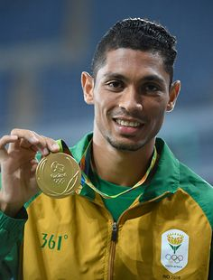Gold medalist Wayde van Niekerk of South Africa poses on the podium during the…