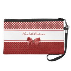 A girly red and white wristlet with cute red and white polka dots on the bottom, chic gingham on the top and embellished with a red ribbon tied into a bow. Personalize this stylish cosmetics bag by adding your name.