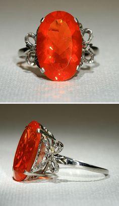 Art Deco Platinum 4.75ct Fire Opal Ring with Diamond Bows. Circa 1930