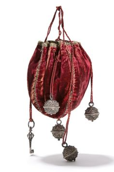 Velvet pouch with silver balls, the Netherlands, 1st half of 17th century. In the Netherlands, women wore such pouches on a harmess, a chatelaine, or belt to carry money.