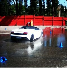 First task for me at Lamborghini Academy is corner practice. WHY DO WE NEED THE SPRINKLER?! - Instagram by @michaelturtle