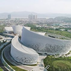 PES Architects used custom-developed ceramic tiles and louvres to create the curving lines of the Strait Culture and Art Centre in Fuzhou, China. China Architecture, Parametric Architecture, Architecture Graphics, Futuristic Architecture, Facade Architecture, Contemporary Architecture, Amazing Architecture, Concept Architecture, Ancient Architecture