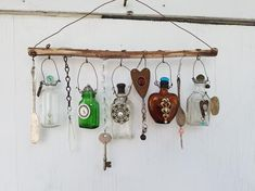 bottle crafts diy Example of Made when ordered Bottle Chime/Vintage Bottles Embellished with Found Objects, buttons beads, etc. Altered Bottles, Antique Bottles, Vintage Bottles, Bottles And Jars, Driftwood Crafts, Wire Crafts, Diy And Crafts, Arts And Crafts, Bottle Art