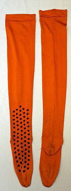 Embroidered orange silk stockings, American, 1890s.