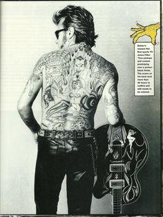 His back tattoos be impressive af /@sarahdeanbaker