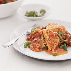 Spanish Chicken and Rice;Simmer seasoned chicken breast pieces, veggies, and rice together in a tomato -based sauce for a flavorful and low-fat one-dish meal. Top the finished dish with chopped olives
