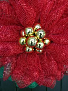 This is a revision of a very popular tutorial on making a Poinsettia mesh wreath. Initially, kits were available with products for this