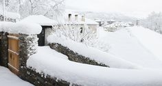 Snow has covered all houses in this traditional stone village in Zagorochoria in North-Western Greece
