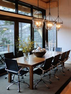 Love the modern and rustic mix.  Especially love the conference room chairs in the dining room.