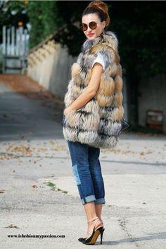 fur vest with denim jeans