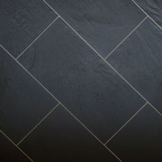 Black slate tile in subway pattern.