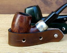 Brown leather pipe stand: www.sorringowlandsons.etsy.com